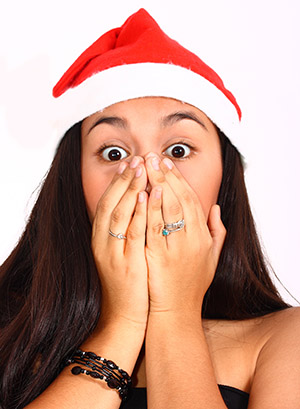 Girl Wearing A Santa Hat Surprised And Excited At Christmas